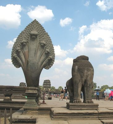 The restored head of a naga beside an unrestored lion at the start of the causeway leading to the entrance of Angkor Wat. The contrast of restored and unrestored figures is deliberate. The major restoration of the causeway was first initiated in the 1960s by the French.