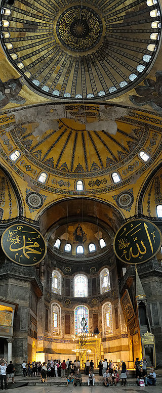Interior view of the Hagia Sophia, showing Islamic elements on the top of the main dome