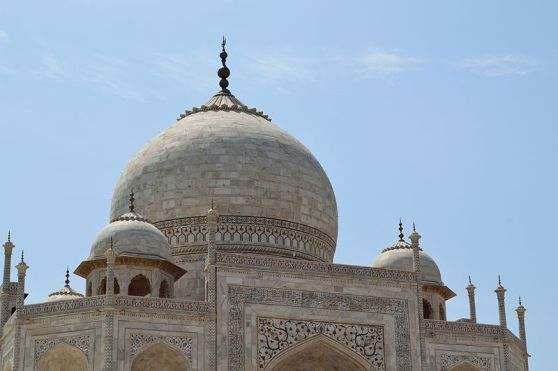 Main marble dome, smaller domes, and decorative spires that extend from the edges of the base walls.